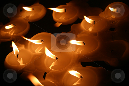 Floating candles stock photo, Candles floating on a swimming pool by Sean Nel
