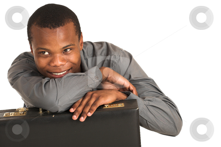 Businessman #146 stock photo, Businessman in grey shirt, holding a leather suitcase, smiling.  Copy space. by Sean Nel