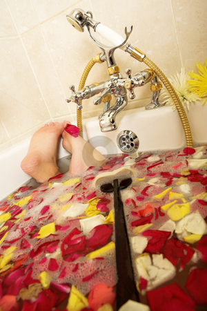 Woman #191 stock photo, Feet of a person in a bath. by Sean Nel