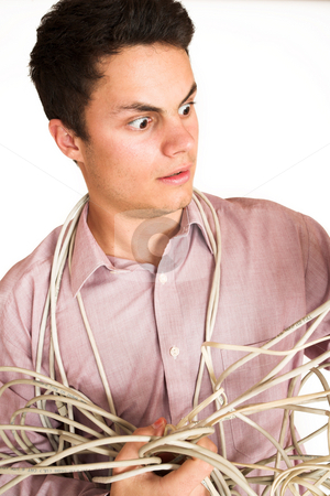 Businessman #123 stock photo, Businessman tangled up in a electric cable.  Looking worried. by Sean Nel