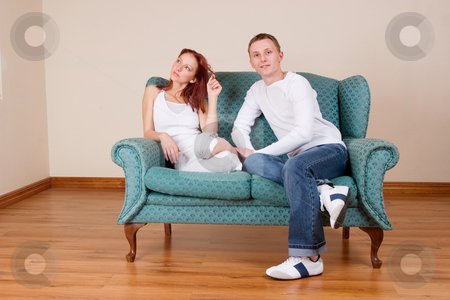 Trudy-Lee & Tommy #11 stock photo, Woman and boyfriend sitting on couch by Sean Nel