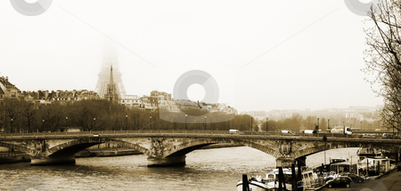 Paris #8 stock photo, Bridge in Paris, France. Eiffel Tower just visible in the fog.  Movement on cars driving  by Sean Nel