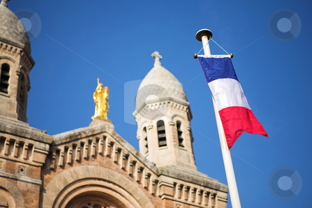 StRaphael #16 stock photo, The Victoire de Lepante Cathedral in Victory Square, St Raphael, France - Shallow DOF, focus on Flag by Sean Nel