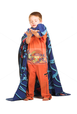 Kids #1 stock photo, A boy wearing a blanket as a cape, holding out his hand.  Eyes closed. by Sean Nel