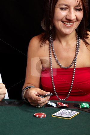 Card gambling stock photo, People playing cards, chips and players gambling around a green felt poker table. Shallow Depth of field. Focus on the Hand and Chips by Sean Nel