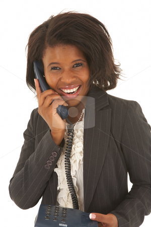 Beautiful African businesswoman stock photo, Portrait of a beautiful young African businesswoman talking on the phone on white background. NOT ISOLATED by Sean Nel