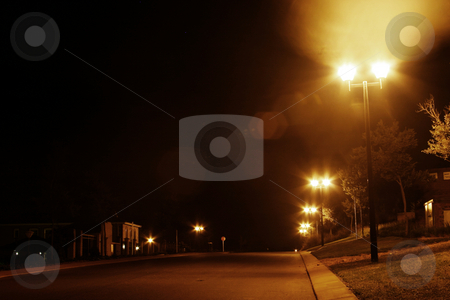 Down my street stock photo, Lit up street at night by Sean Nel