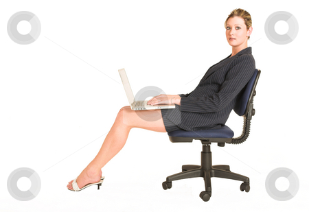 Laura Hopton #2 stock photo, Business woman sitting on a office chair with a laptop on her lap by Sean Nel