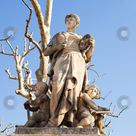 Statues in Aix-en-Provence stock photo, Old weathered statues on the old town square and marketplace in Aix-En-Provence, France. Outlined against a blue sky on a bright winter day by Sean Nel