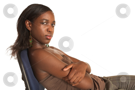 Cynthia Akva #12 stock photo, African business woman dressed in neutral coloured clothes. Sitting on office chair.  Copy Space by Sean Nel