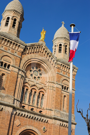 StRaphael #21 stock photo, The Victoire de Lepante Cathedral in Victory Square, St Raphael, France - Shallow DOF, focus on Flag by Sean Nel