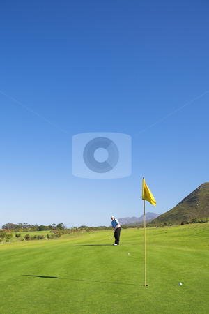 Golfer #42 stock photo, A male playing golf. by Sean Nel