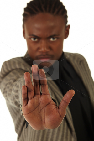 Black Businessman stock photo, Black African businessman on a white background in various positions, stances and with various facial expressions. Part of a series - Shallow DOF, focus on hand - NOT ISOLATED by Sean Nel
