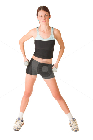 Gym #152 stock photo, Woman in gym wear standing with weights on her hips. by Sean Nel