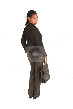 Mida Matsimela #3 stock photo, African business woman dressed in black jacket. Standing, looking over her shoulder with leather suitcase in her hand by Sean Nel