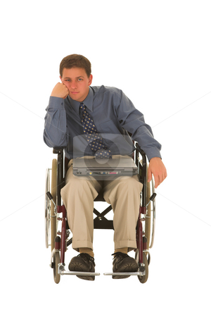 Businessman #139 stock photo, Businessman sitting in a wheelchair with a laptop by Sean Nel