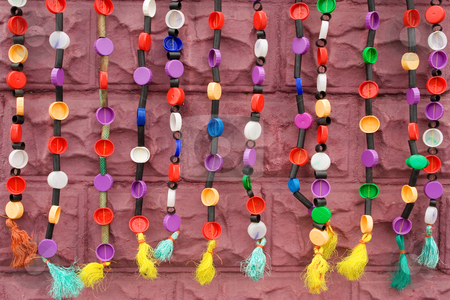 Beading #1 stock photo, Strings of ethnic beadwork hanging against a wall by Sean Nel