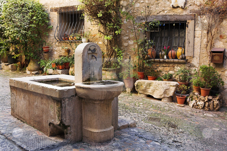 Village of Saint-Paul stock photo, Fresh water fountain in the centre of the quaint little French hilltop village of Saint-Paul de Vence, Southern France,  Alpes Maritimes, next to the Mediterranean sea - A Heritage Site by Sean Nel