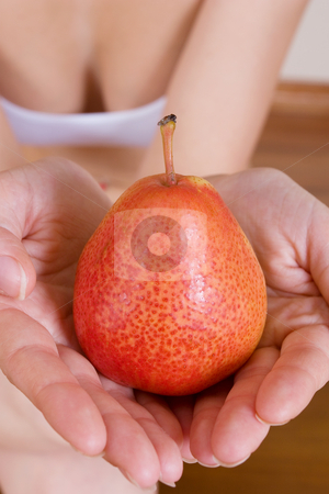 Fruit #3 stock photo, Close-up of female hands holding a pear by Sean Nel