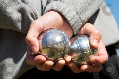 Petanque stock photo, The hands of a man holding Petanque (boule) balls by Sean Nel