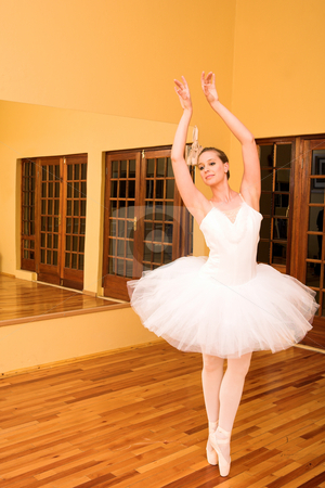 Ballerina #32 stock photo, Ballerina dancing in front of a mirror by Sean Nel