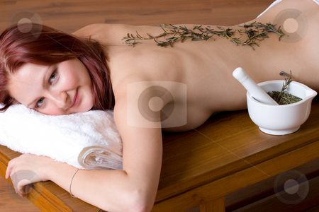 Massage #16 stock photo, Woman lying on massage table with lavender twigs on clean naked back - Eyes open by Sean Nel