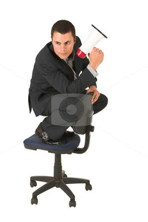 Businessman #247 stock photo, Businessman wearing a suit and a grey shirt.  Making a stunt on an office chair with a megaphone in his hand. by Sean Nel