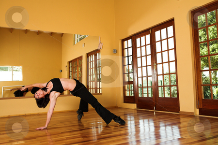 Dancer #10 stock photo, A Female Dancer practicing in her studio by Sean Nel