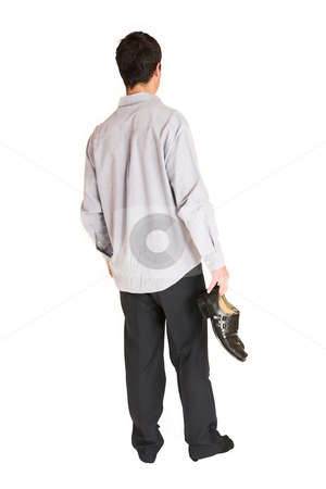 Businessman #107 stock photo, Businessman standing in socks, holding shoes in one hand. by Sean Nel