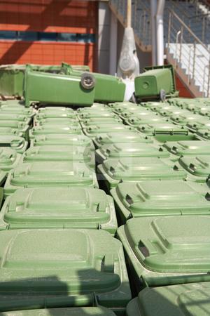 Rubbish bins stock photo, Stacks of green rubbish bins standing outside a sports stadium. by Sean Nel