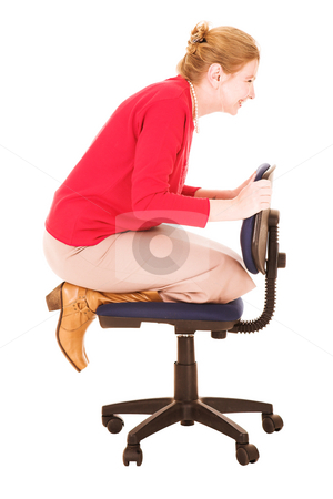 Businesswoman playing on office chair stock photo, Blonde businesswoman playing on an office chair. Isolated on white by Sean Nel