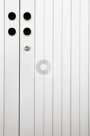 Locked file cabinet stock photo, Slatted doors of a closed and locked aluminum file cabinet (texture on slats is from the aluminum, not noise) by Sean Nel