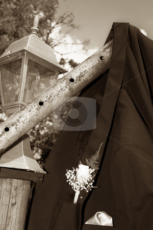 Wedding #41 stock photo, A suit jacket of a groom hanging over a pole.  Shallow D.O.F by Sean Nel
