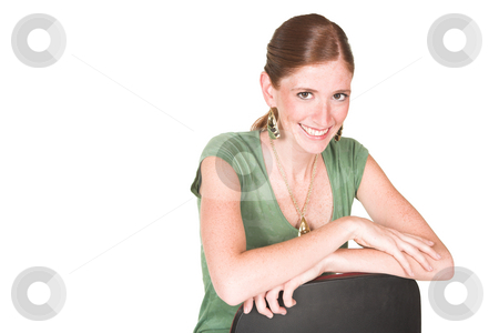 Young businesswoman stock photo, Sexy young adult Caucasian businesswoman in a green top and brown pants with gold jewelry by Sean Nel