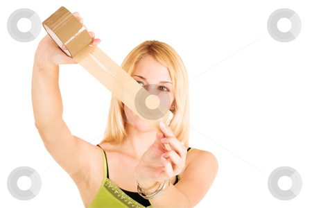 Businesswoman taping up a   stock photo, Blonde businesswoman in an informal green top. Holding a piece of stickytape.  Shallow DOF, hands and tape in focus, face out of focus.  Copy space. by Sean Nel