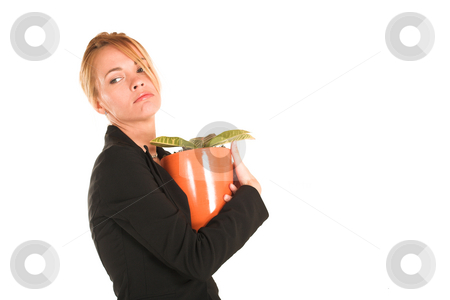 Businesswoman #241 stock photo, Blonde business lady in formal black suit.  Holding a potplant, looking sad - copy space by Sean Nel