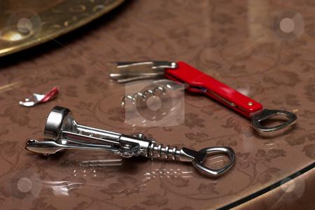 Bottle openers stock photo, Bottle openers on glass by Sean Nel