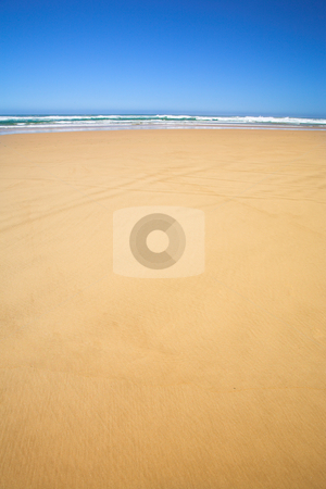 Flat beach with Blue Sky stock photo, The wide flat beach at the Noetzie reserve, Western Cape, South Africa by Sean Nel