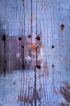 Old wooden plank texture stock photo, Old wooden door texture with nail holes. Blue cast by Sean Nel