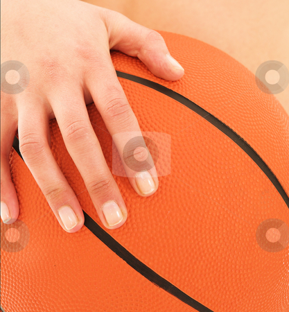 Woman holding Basketball  stock photo, Woman holding basketball by Sean Nel