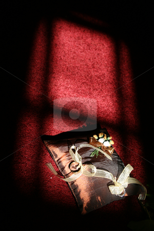 Weddingrings stock photo, Ring cusshion in window light by Sean Nel