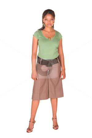 Sexy african businesswoman stock photo, Sexy young adult african businesswoman in green top and brown medium length pants on a white background. NOT ISOLATED by Sean Nel