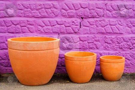 Pots #2 stock photo, Colourful pots on gravelroad next to purple wall by Sean Nel