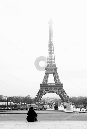 Paris #43 stock photo, A person sitting, looking at the Eiffel Tower in Paris, France.  Black and white.  Copy space. by Sean Nel