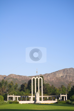 The Huguenot Monument stock photo, The Huguenot Monument in summer with green grass and blooming gardens in Franschhoek, Western Cape, South Africa by Sean Nel