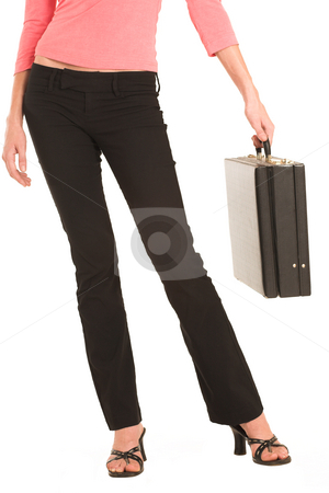 Business Woman #424 stock photo, Business woman in  an informal light pink shirt, black pants and high heel shoes.  Holding a leather suitcase. by Sean Nel