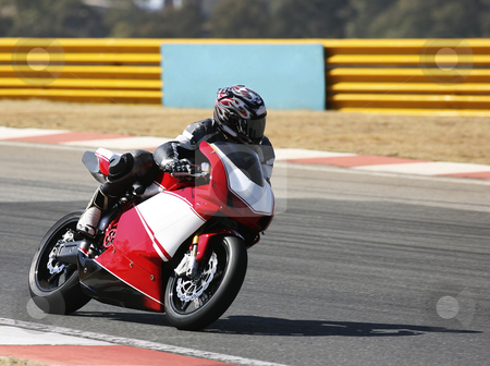 Superbike #84 stock photo, High speed Superbike on the circuit  by Sean Nel