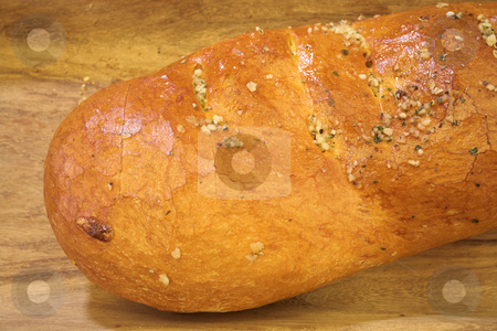 Bread #6 stock photo, Loaf of bread on wooden plank by Sean Nel