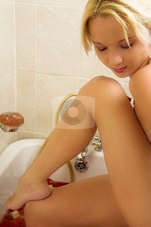 Woman #33 stock photo, Nude woman in a bath.  Looking down. by Sean Nel