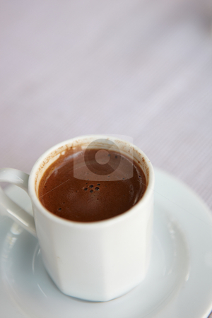 Turkish coffee stock photo, Small white cup of turkish coffee as served in a small rural cafe in Turkey. Very Shallow Depth of Field by Sean Nel